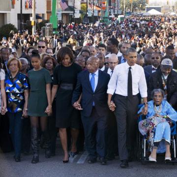 Image: Barack Obama, Michelle Obama, Malia Obama, Sasha Obama, Marian Robinson, John Lewis, Amelia Boynton Robinson