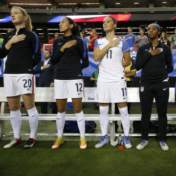 Image: Megan Rapinoe kneels during national anthem