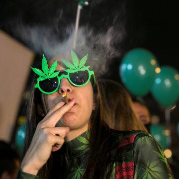 Image: A woman smokes in Tel Aviv, Israel, on Feb. 4, 2017