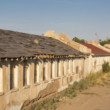 Image: A building in the historic Rio Vista Farm in Socorro, Texas.