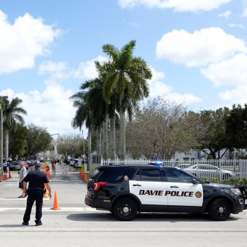 Image: Police vehicles are seen outside the David Posnack Jewish Day School after the second bomb threat in a month was reported in Davie, Florida, U.S. March 7, 2017.  REUTERS/Andrew Innerarity