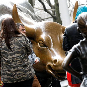 Image: A statue of a girl facing the Wall St. Bull is seen in the financial district in New York