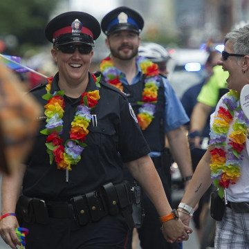 12-07-01 - TORONTO, ONTARIO - TPS Constable Danielle Bottineau (left) and wife Karin Dafont, walk ha