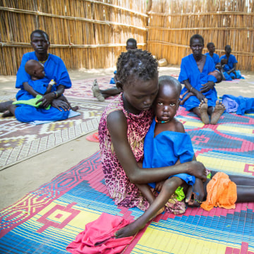 Image: Moms hold malnourished children in South Sudan