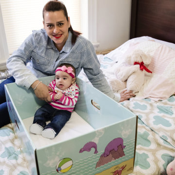 Image: Dolores Peterson and her three-month-old daughter Ariabella pose for a photograph at their home in Camden, New Jersey, March 6, 2017.
