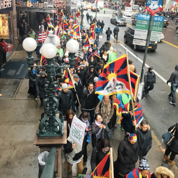 "Demonstrators pass through Times Square on Friday, March 10, 2017, shouting slogans such as, ""Free Tibet"" and ""Allow media in Tibet,"" while passing out pamphlets on the history of Tibetan National Uprising Day."