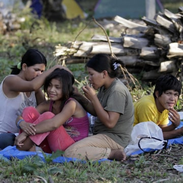 Image: Tsimane indigenous people rest during a march to Yucumo, Bolivia