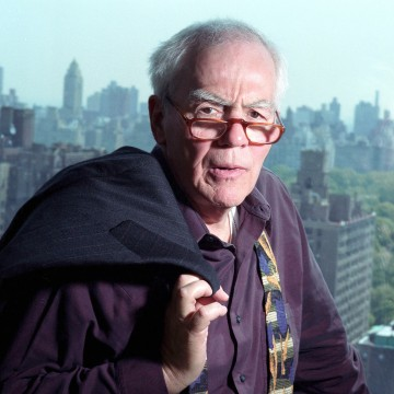 Image: Columnist Jimmy Breslin poses in his New York apartment, May 7, 2002.