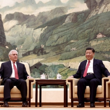 Image: China's President Xi Jinping (right) meets with Secretary of State Rex Tillerson