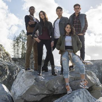 "From left to right: Billy the Blue Ranger (RJ Cyler), Kimberly the Pink Ranger (Naomi Scott), Zack the Black Ranger (Ludi Lin), Trini the Yellow Ranger (Becky G) and Jason the Red Ranger (Dacre Montgomery) in ""Power Rangers."""