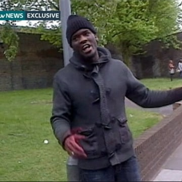 Image: Still image of Adebolajo showing a bloodied hand and knives following the murder of soldier Rigby in Woolwich