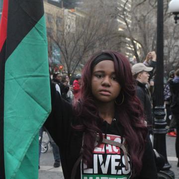 Nupol Kiazolu at March 24, 2017, NYC Resists Hate Crimes march.