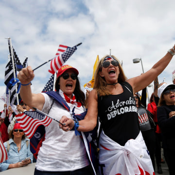 Image: Demonstrators protest at the beach in support of U.S. President Donald Trump during a rally in Huntington Beach