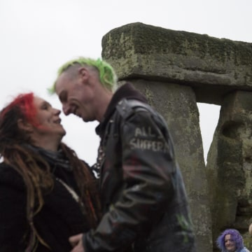 Image: A couple celebrates their symbolic marriage at Stonehenge