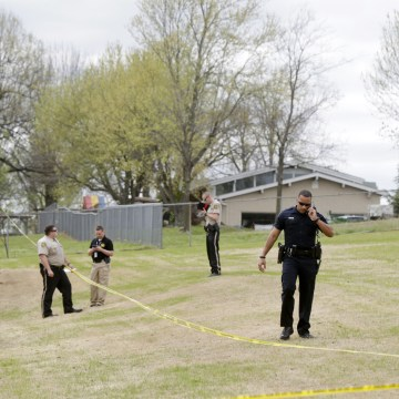 Image: Police investigate the scene of a failed robbery in Broken Arrow, Okla.
