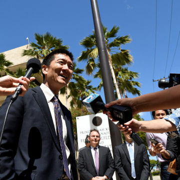 Image: Hawaii Attorney General Douglas Chin talks to the media