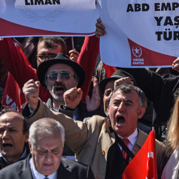 "Image: Supporters of the Vatan Partisi, or Patriotic Party, shout slogans and hold signs condemning ""American imperialism"""