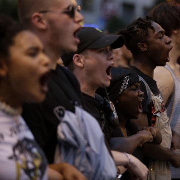 Image: Demonstrators chant as they protest in Chicago