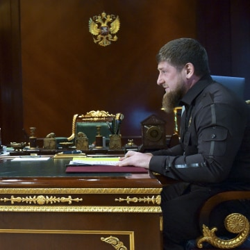 Image: A newspaper says police in Chechnya, ruled by Ramzan Kadyrov (right) have rounded up more than 100 suspected gay men