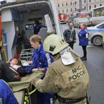 Image: An injured person is helped by emergency services