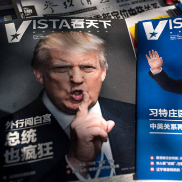 Image: Magazines featuring front pages of US President Donald Trump and China's President Xi Jinping