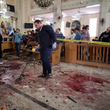 Image: Security personnel investigate the scene of a bomb blast inside a church