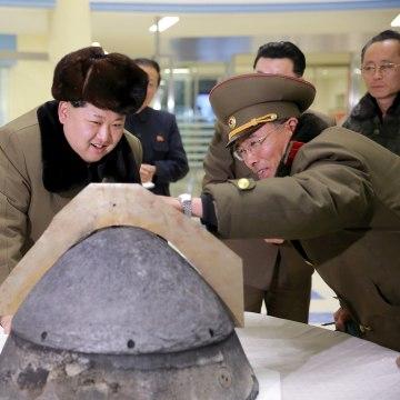 Image: Kim Jong Un looks at a rocket warhead tip