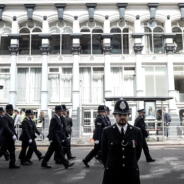 Image: Police officers march towards Southwark Cathedral for the funeral route of PC Keith Palmer