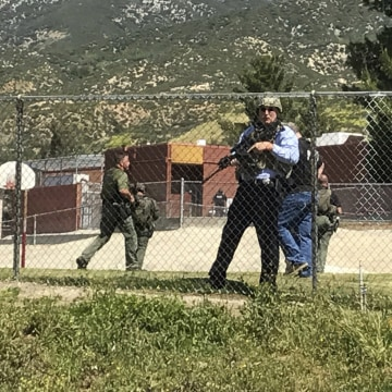 Image: Emergency personnel respond to a shooting inside North Park School Elementary School