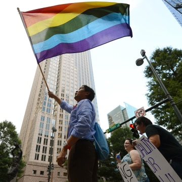 Image: Marchers celebrate after the Supreme Court struck down the Defense of Marriage Act