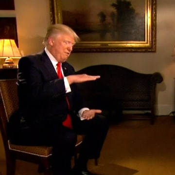 """Image: Trump gestures during his interview with Fox Business Network's Maria Bartiromo to illustrate the size of the """"beautiful chocolate cake"""""""