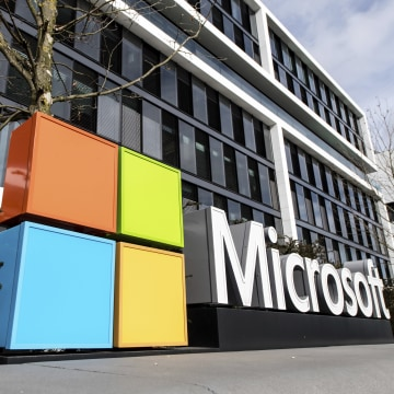 Image: The Microsoft logo on the facade of a Microsoft Center.