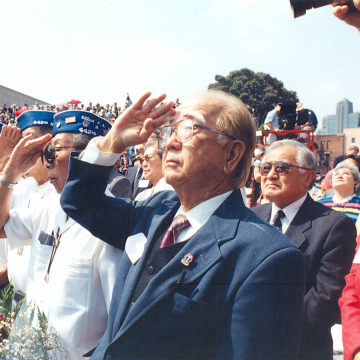 Image: WWII Nisei veterans saluting the flag at the Go For Broke monument in downtown Los Angeles.