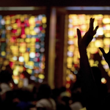 Image: Worshipers puts their hands up before Hillary Clinton takes the stage at New Mount Olive Baptist Church in Fort Lauderdale, Florida, Oct. 30, 2016.
