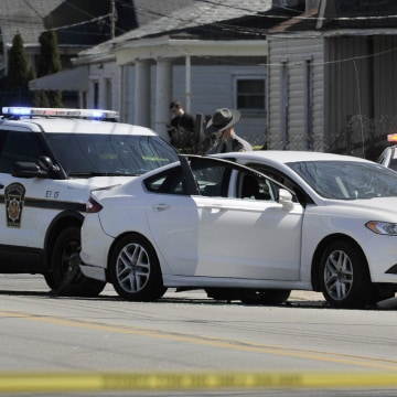 Image: Police investigate the scene where Steve Stephens was found shot dead
