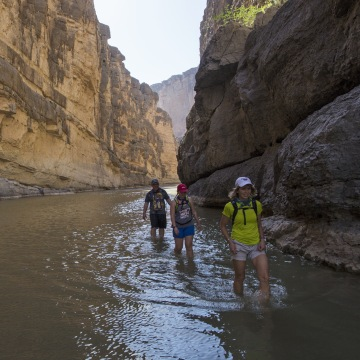 Image: Tourists walk in the water of the Rio Grande River in Big Bend National Park in Texas