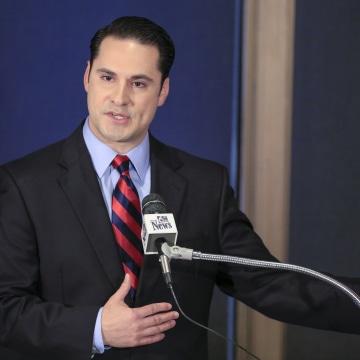 Image: Heath Mello speaks during a debate