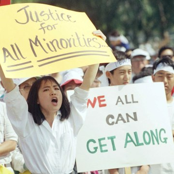 Image: A crowd rallies in Koreatown's Admiral Park in Los Angeles to call for healing between Koreans and the African-American community