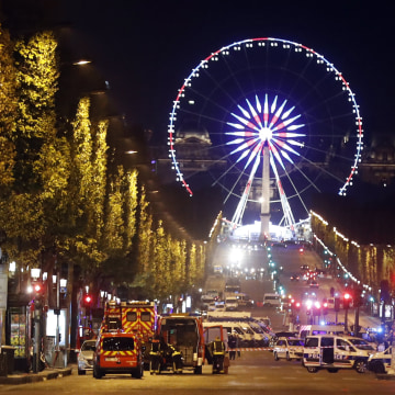 Image: Police block the Champs Elysees after a shooting attack in Paris