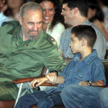 Image: Cuban President Fidel Castro (L) speaks to Cuban boy Elian Gonzalez during the a graduation ceremony..