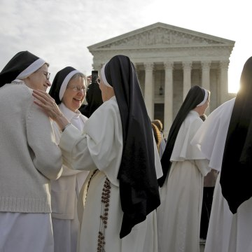 Image: Nuns speak to each other before Zubik v. Burwell is heard by the U.S. Supreme Court in Washington