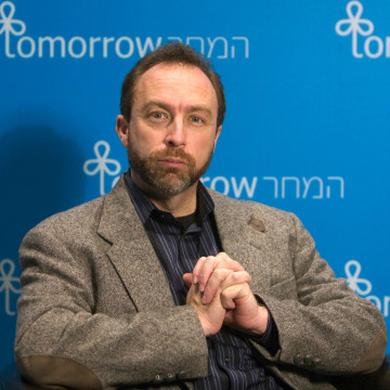 Image: FILE PHOTO - Jimmy Wales, founder of the user-edited Wikipedia, pauses during an interview with Reuters in Jerusalem