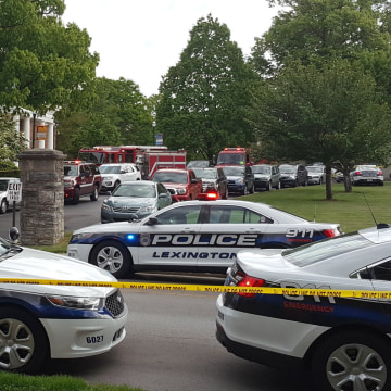 Image: Police cars outside the cafe where a student at Transylvania University was attacked