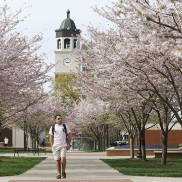 Image: A student walks on Western Kentucky University's campus
