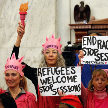 Image: Protesters hold signs at Jeff Sessions confirmation hearing to become U.S. attorney general