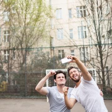 Friends Taking Selfie At Urban Soccer Ground