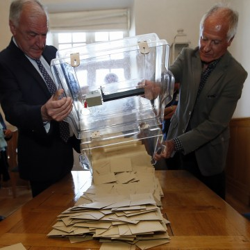 Image: A ballot box is emptied in Saint-Jean-de-Luz, France