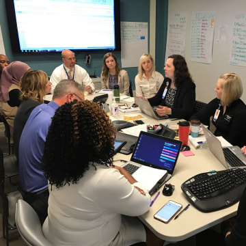 Image: Image: Patsy Stinchfield, Sr. Director of Infection Prevention, Skin Integrity, and The Children's Immunization Project leads a meeting on the measles outbreak in the command center