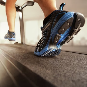 Image: Man running in a gym on a treadmill concept for exercise