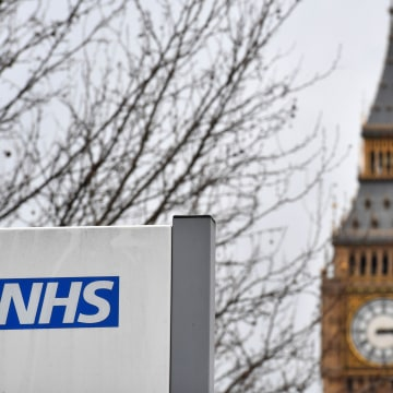 Image: A NHS sign is displayed outside a hospital in central London